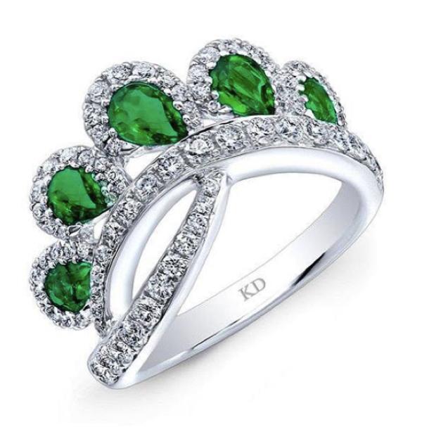 Emerald ring with diamonds around it